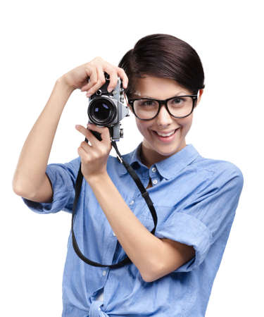 Hipster in spectacles hands retro photographic camera, isolated on white Stock Photo - 14980247