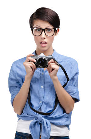 Hipster woman in spectacles hands retro photographic camera, isolated on white photo