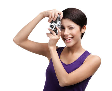 Competent woman in spectacles hands retro photographic camera, isolated on white photo