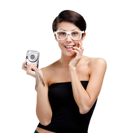 Woman holds amateur hand-held  silver camera, isolated on white Stock Photo - 14980164