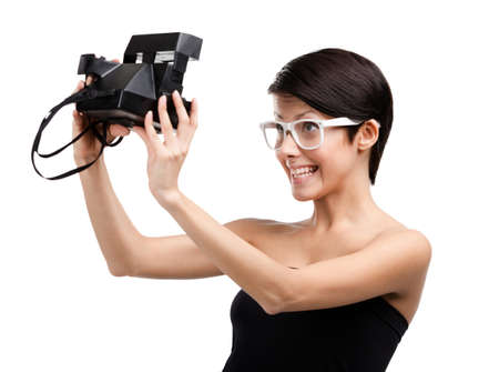 Woman takes images with cassette photographic camera, isolated on white photo