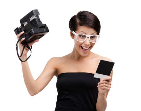 Woman takes snapshots with cassette photographic camera, isolated on white Stock Photo - 14980248