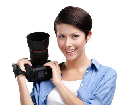 Lady-photographer takes shots, isolated on white Stock Photo - 14980332