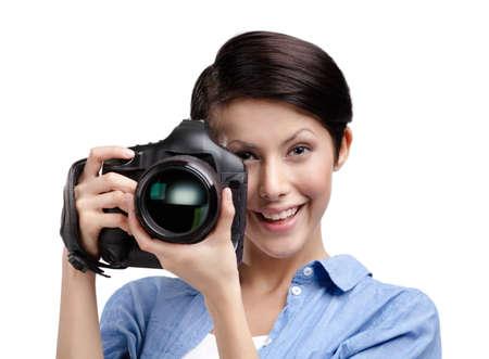 Woman-photographer takes snapshots, isolated on white Stock Photo - 14980323