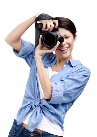 Vrouw-fotograaf neemt beelden, geïsoleerd op witte achtergrond