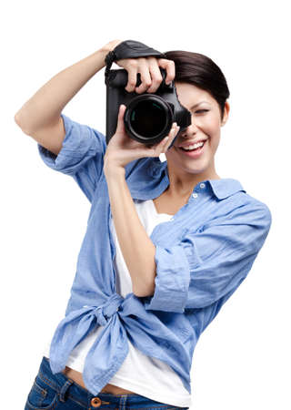Woman-photographer takes images, isolated on white background photo