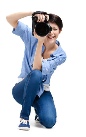 gladly: Creative woman-photographer takes photos, isolated on white