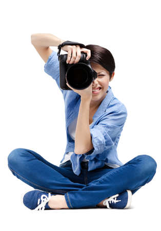 Lady-photographer takes images, isolated on white Stock Photo - 14980327