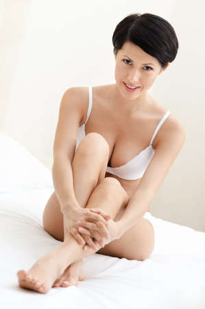 woman sits on the wonderful bed photo