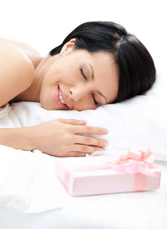 Sleeping woman and surprise on the bed, white background photo