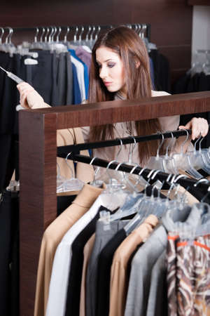 Woman is seeking for perfect garments photo