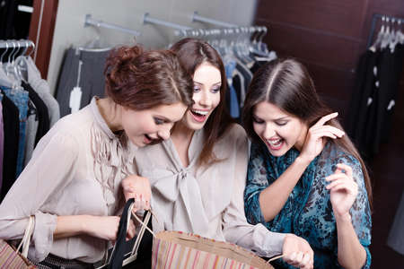 Girls admire the purchases of their friend photo