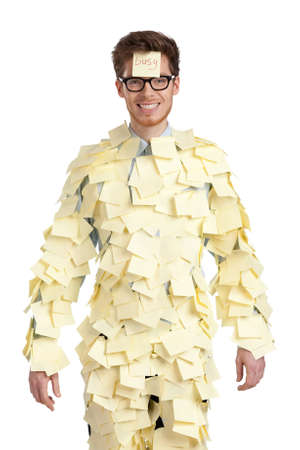 assert: Young male with a sticky note on his face, covered with yellow stickers, isolated on white Stock Photo
