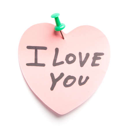 assert: Pink sticky note with written words I love you Stock Photo