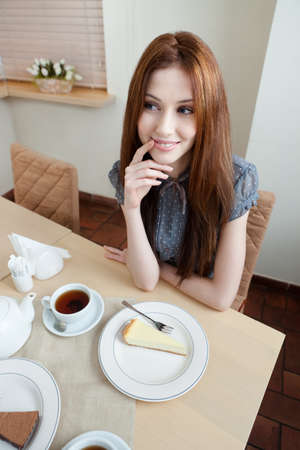 Woman is at the restaurant, wide angle Stock Photo - 15044493