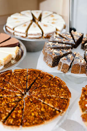 Bakery window full of different pieces of pies Stock Photo - 15089089