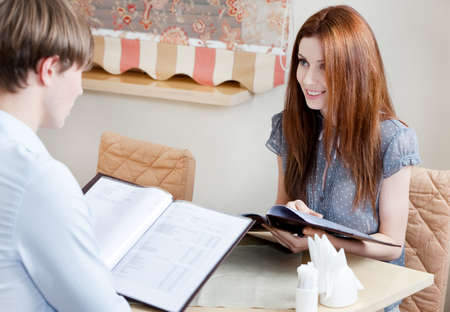 adult intercourse: Couple keeps the menu to make an order at the cafe Stock Photo
