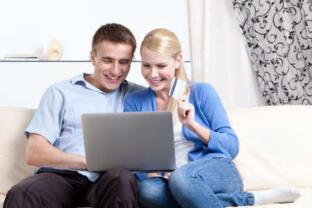 makes: Couple makes purchases on the internet using credit card Stock Photo