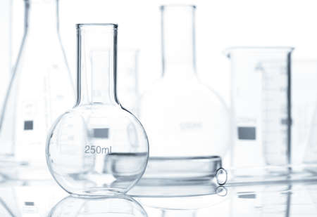 Set of empty classic laboratory flasks with reflection on the surface of the table, isolated Stock Photo