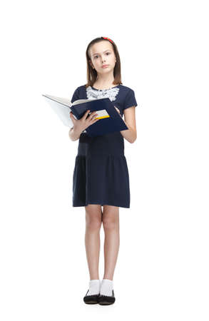 Reading schoolgirl carries her books, isolated, white background photo