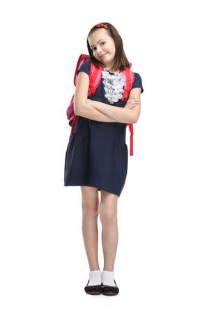 Schoolgirl with the briefcase with crossed arms, isolated, white background photo