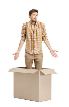 moving out: Young man doesnt know why he is inside the box, isolated, white background