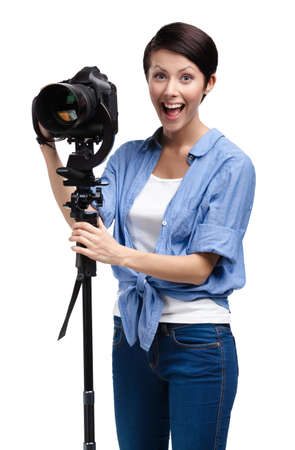 tripod: Girl takes photos holding photographic camera, isolated on white