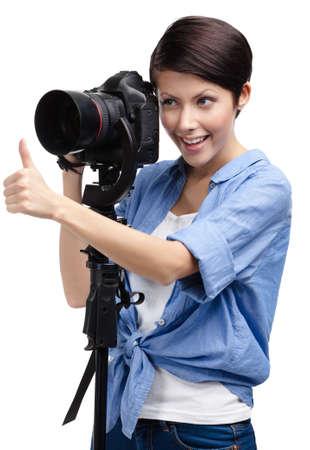 avocation: Lady takes shots holding photographic camera, isolated on white