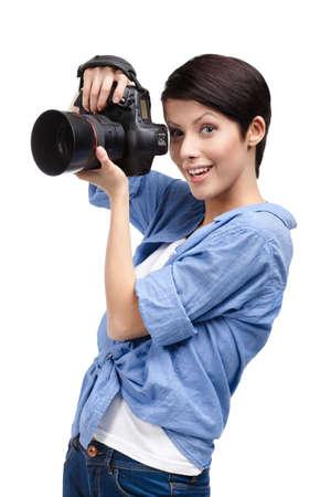 Lady takes photos holding photographic camera, isolated on white Stock Photo - 15044469