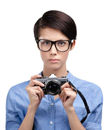 Beautiful woman in spectacles hands retro photographic camera, isolated on white photo