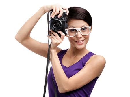Woman in spectacles hands professional photographic camera, isolated on white photo