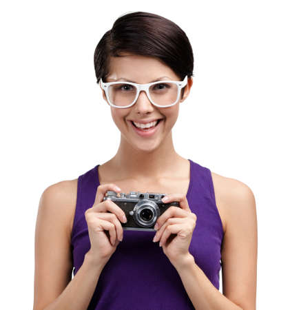 Lady in spectacles hands retro photographic camera, isolated on white Stock Photo - 15044405