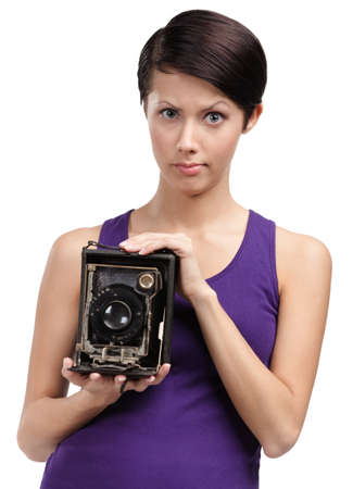 rarity: Woman with rarity photographic camera, isolated on white