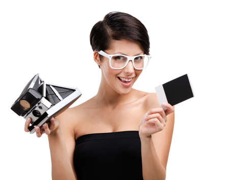 Woman takes pictures with cassette photographic camera, isolated on white Stock Photo - 15044411
