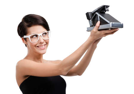 avocation: Woman takes photos with cassette photographic camera, isolated on white Stock Photo
