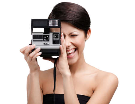 Lady takes photos with cassette photographic camera, isolated on white Stock Photo - 15044420