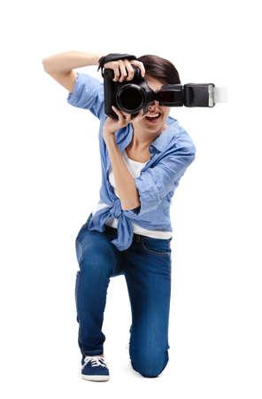Girl takes photos, isolated on white Stock Photo - 15044388