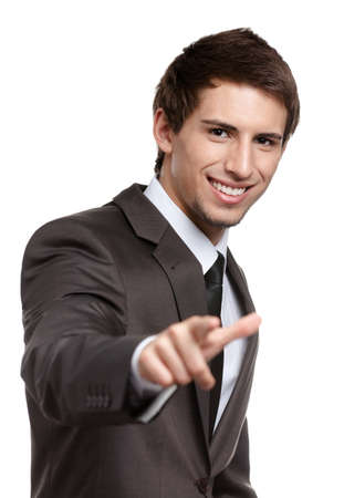Portrait of smiling business man gesturing pointing forefinger at you, isolated on white Stock Photo - 15044458