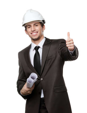 Engineer in white hard hat and keeping drafts thumbs up, isolated on white Stock Photo - 15044391