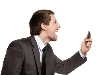 adult intercourse: Angry business man screaming on cell mobile phone, concept of executive yelling, conversation problem and communication crisis, isolated on white Stock Photo