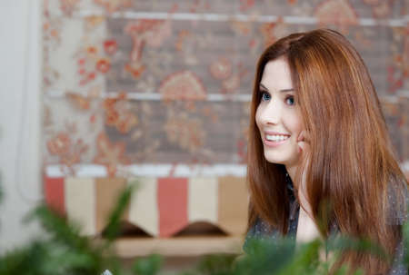 adult intercourse: Attractive woman speaks on the phone at the cafe