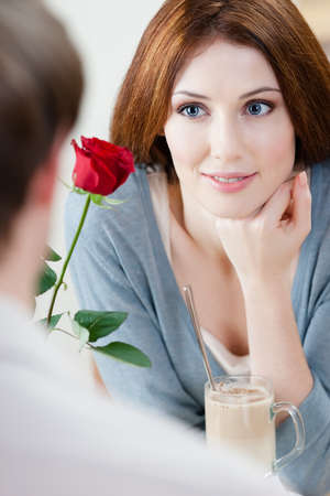 adult intercourse: Woman at the cafe with red rose and her boyfriend Stock Photo