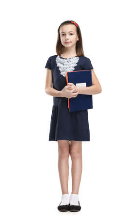 Schoolgirl carries her books, isolated, white background photo