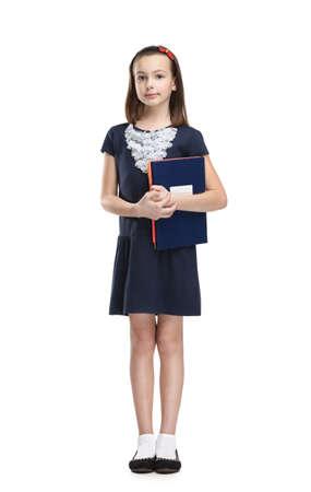 full uniform: Schoolgirl carries her books, isolated, white background