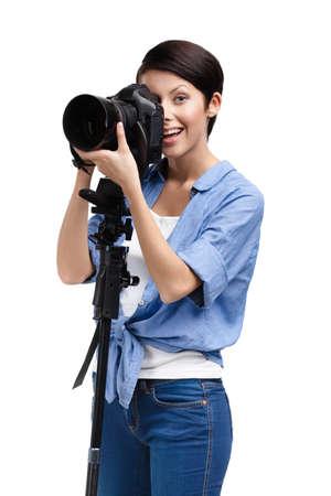 Lady takes snapshots holding photographic camera, isolated on white Stock Photo - 15177393