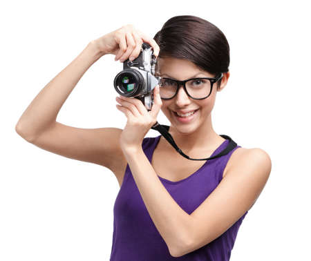 Attractive lady in spectacles hands retro photographic camera, isolated on white photo