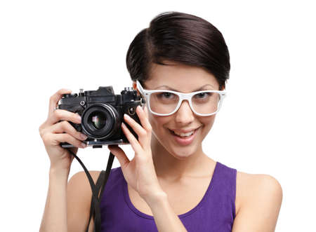 Lady in spectacles hands professional photographic camera, isolated on white photo