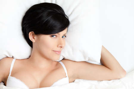 Sleeping sexy woman in the wide bed, white background Stock Photo - 15177387