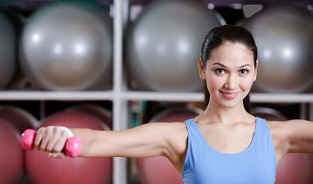 Sportive woman training with dumbbells in gym. Gymnastics Stock Photo - 15177370