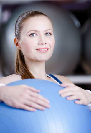 Athlete woman with blue gym ball in fitness gym photo